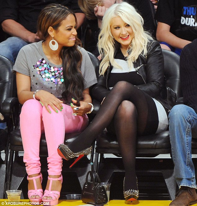 christina aguilera and christina milian at nba lakers vs thuder game