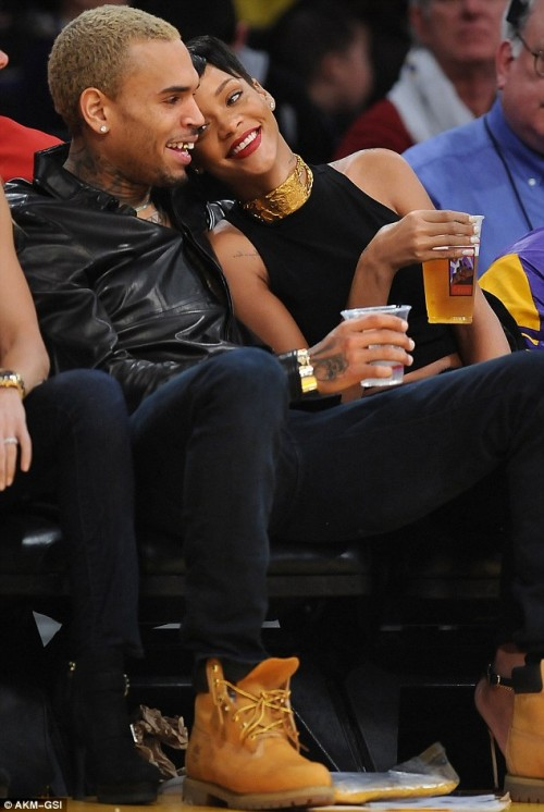 chris brown rihanna christmas e1356485098240 Nobodys Business: Rihanna & Chris Brown Get Cosy At NBA Game