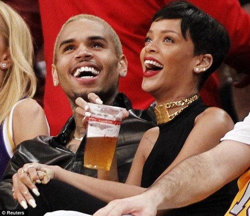 chris brown rihanna e1356485311900 Nobodys Business: Rihanna & Chris Brown Get Cosy At NBA Game