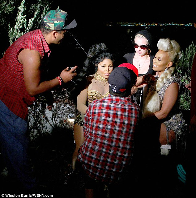 Hot Shots: Lil Kim Shoots Twisted Video With Tiffany Foxx & Miley Cyrus