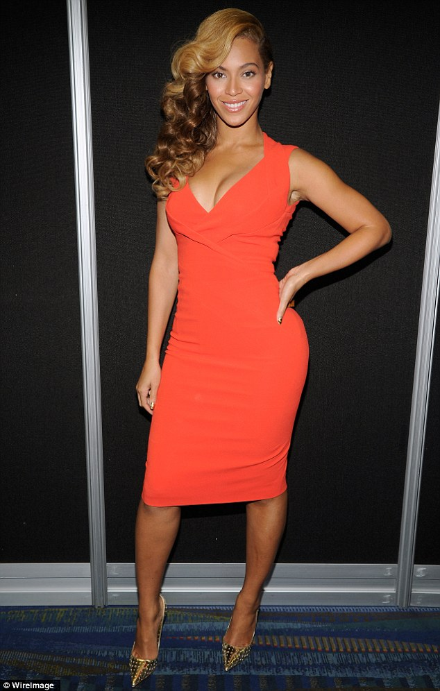 Hot Shots: Beyonce Rocks Red At Super Bowl Press Junket