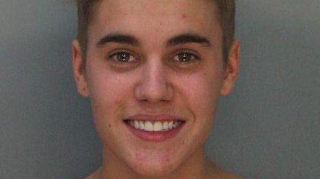Justin Bieber Mug Shot Revealed / Singer Smiling