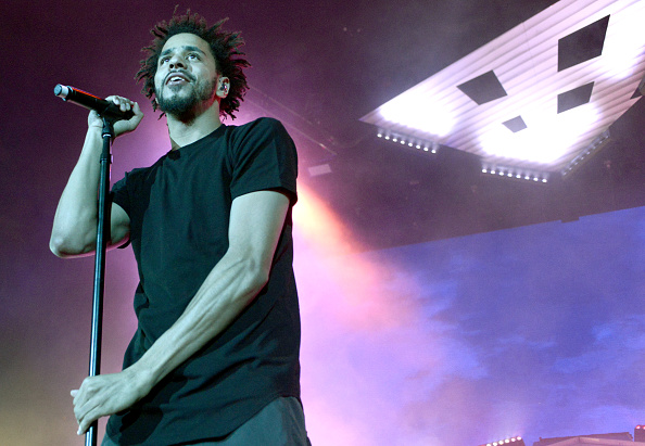 "MOUNTAIN VIEW, CA - JULY 14: J. Cole performs during his ""Forest Hills Drive Tour"" at Shoreline Amphitheatre on July 14, 2015 in Mountain View, California. (Photo by Tim Mosenfelder/Getty Images)"