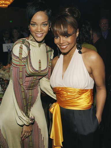 Rihanna, left, and Janet Jackson pose together at the Clive Davis pre-Grammy party in Beverly Hills, Calif. on Saturday, Feb. 9, 2008. (AP Photo/ Matt Sayles)