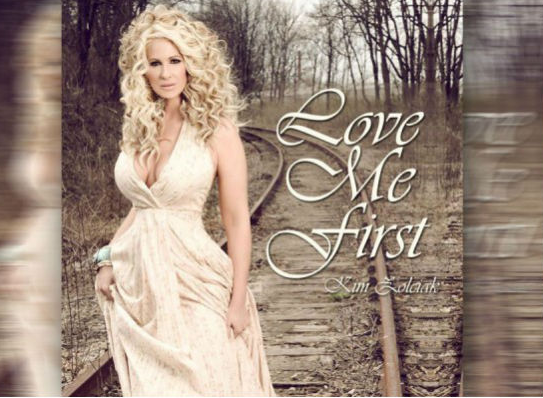 f673570a4cdb3a0344353522ea8c4da0 Kim Zolciak Premieres New Single 'Love Me First' (Listen)